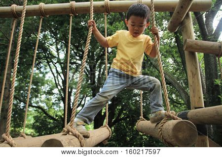 Japanese boy playing at field athletic (3 years old)