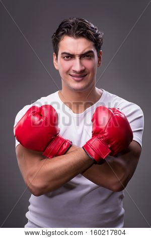 Handsome boxer in boxing concept