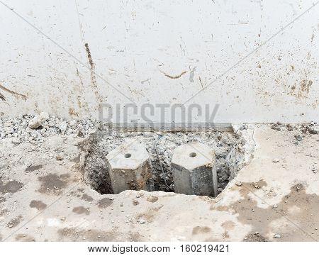 Hexagon concrete pole in the concrete floor of the construction house.