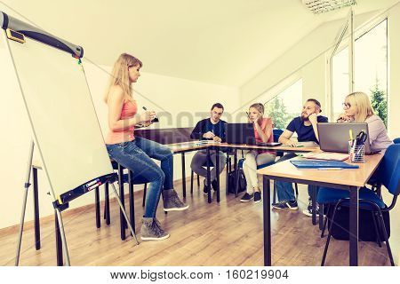 Tired Students And Teacher In Classroom