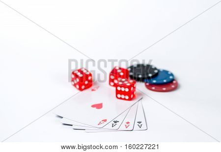 Isolated poker chips dice four aces on a white background
