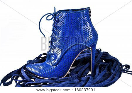 Pair leather shoe with high heels. Sexy women's shoes on a white background. Bright blue ankle boots.