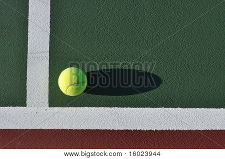 Yellow Tennis Ball On Court
