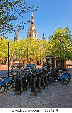 London, UK - April 29, 2011: Bicycles and a steeple of St Clement Danes Church in the City of Westminster in London the UK.