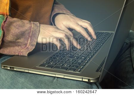 Hand typing on a laptop. Business technology internet and networking concept.