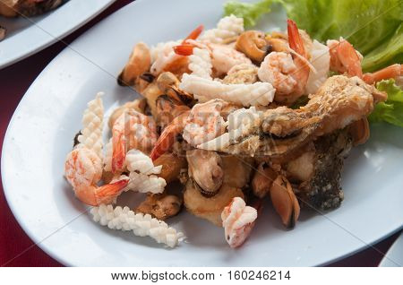 Shell Shrimp Fish and Octopus Seafood on dish with vegetable