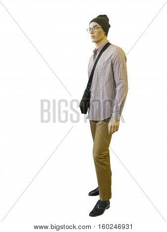 Full length male mannequin with handbag dressed in plaid shirt and trousers isolated on white background. No brand names or copyright objects.