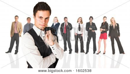Formal Businessman Standing In Front Of A Business People Group