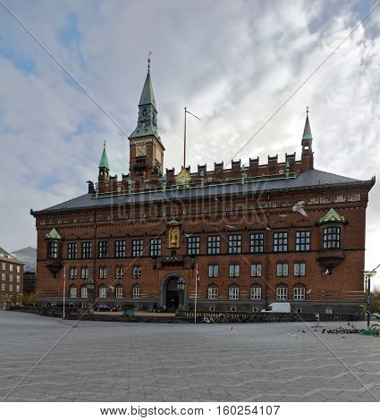 COPENHAGEN, DENMARK - NOVEMBER 7, 2016: People in front of the City Hall. The building was erected in 1905 by design of the architect Martin Nyrop