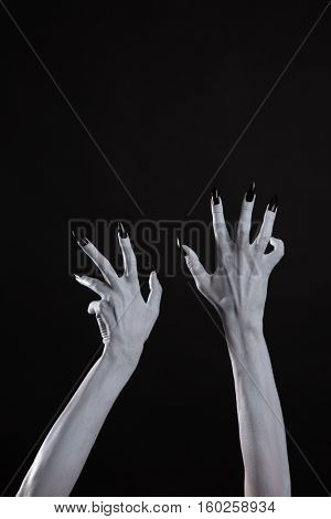 Pale ghost hands with sharp black nails, body art, with copy-space for your text