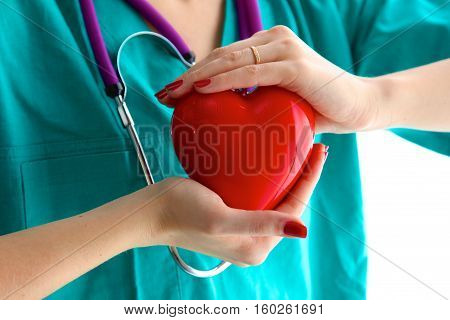 Close-up of unknown female doctor with stethoscope isolated.
