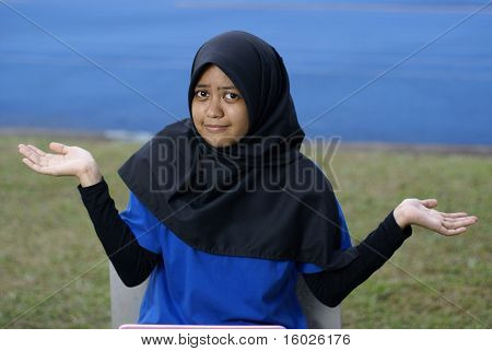Muslim asian girl with puzzled look
