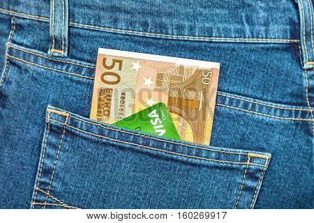 MOSCOW RUSSIA - NOVEMBER 27 2016: Banknote 50 euro and credit card Visa in back jeans pocket