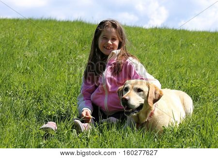 Smiling Little Girl On The Lawn With The Watchdog