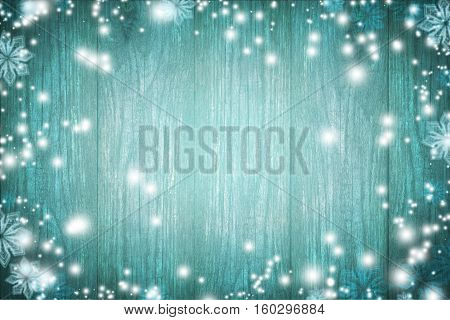 Blue wooden texture. Mysterious Christmas night. Miracle. Fairy tale. Winter. Dark blue christmas background. Snow and snowflakes.