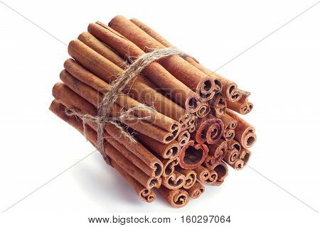 cinnamon sticks in a bunch on a white background