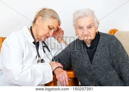Picture of an elderly woman with her worried caregiver