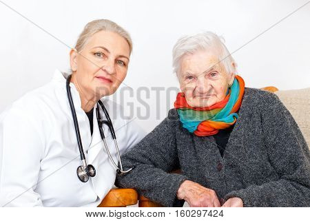 Picture of an elderly woman with her caregiver