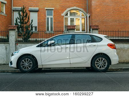 PARIS FRANCE - NOV 29 2016: BMW 2-series Active Tourer family van parked on a calm city. The 2-Series currently competes with new models from Audi and Mercedes-Benz the A3 Sedan and the CLA Class respectively until BMW releases its own front wheel drive/