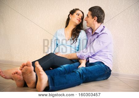 Happy young couple anticipating childs birth at home