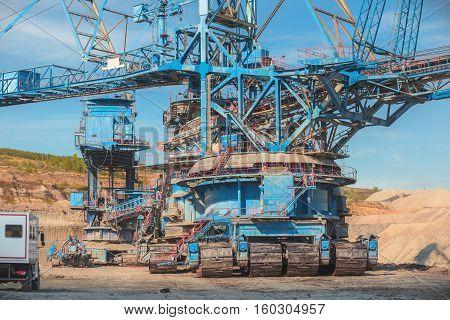 Large excavator machine in the mine working