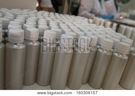 Plastic Bottles On The Assembly Line Of Cosmetic Pharmaceutical Company.