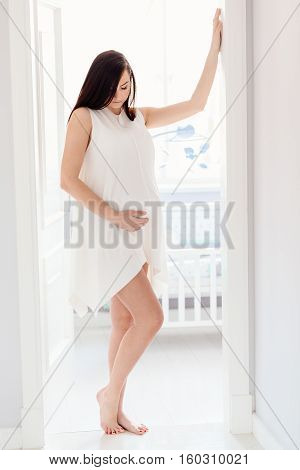 Beautiful Young Pregnant Woman In White Dress