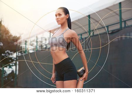 Double exposure of Portrait of a sports woman stretching leg outdoors