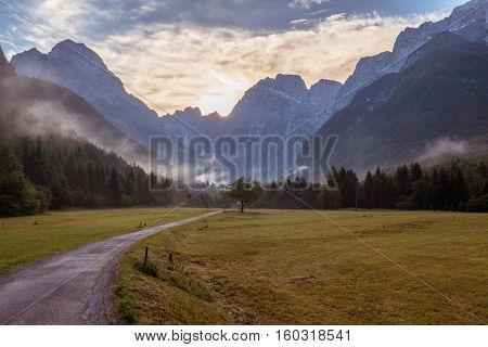 Beautiful Mountain Valley Landscape At Sunrise