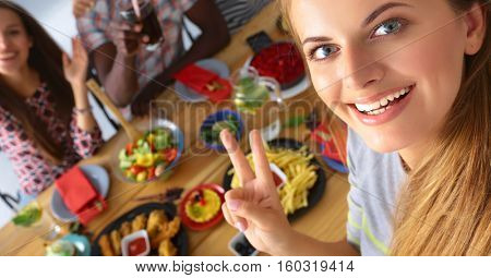 Group of people doing selfie during lunch
