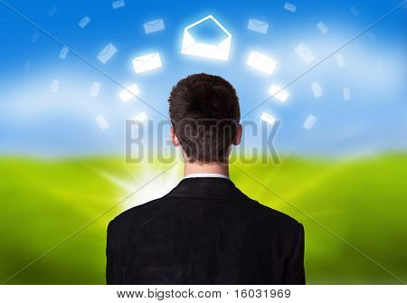 Businessman With E-mail Icons Floating Around His Head 2