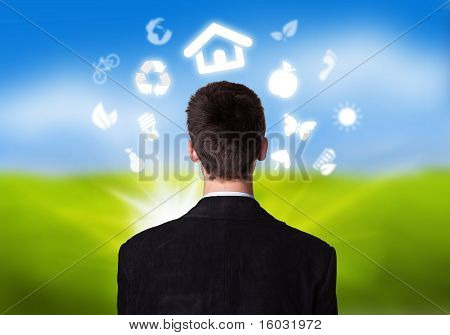 Businessman With Eco Icons Floating Around His Head 2