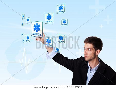 Young Doctor Pressing Medical Button