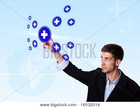 Young Doctor Pressing Blue Cross Button