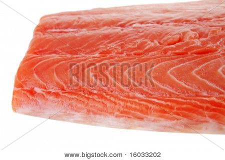 raw salmon fillet isolated over white background .shallow dof