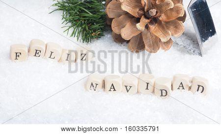 Christmas background with the Spanish words Feliz Navidad of Merry Christmas