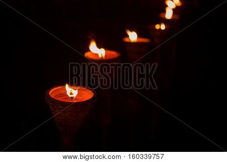 Traditional wooden torch flame at the night