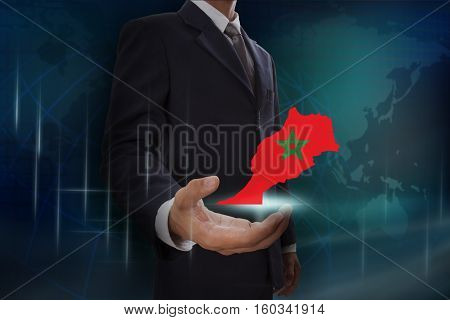 Businessman showing map of Morocco on globe background
