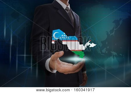 Businessman showing map of Uzbekistan on globe background
