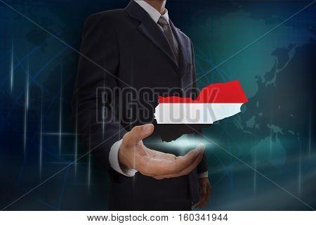 Businessman showing map of Yemen on globe background
