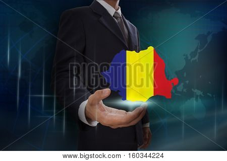 Businessman showing map of Romania on globe background