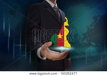 Businessman showing map of Cameroon on globe background
