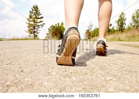 female runner in park lower section closeup