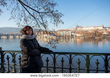 Beautiful Woman In Prague Embankment On River Vltava