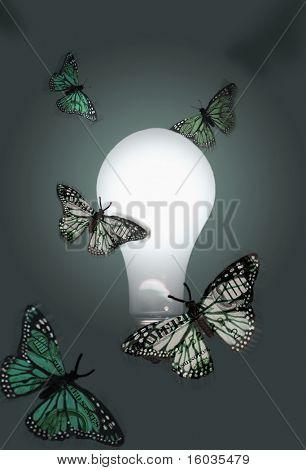 Money winged moths flutter about a lit bulb.