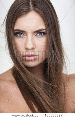 strong facial expression concept - young woman portrait with resentful negative grimace on her face