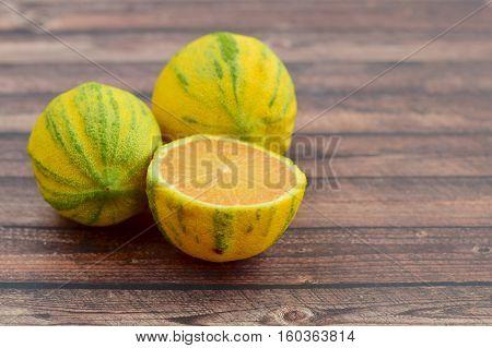 Eureka or pink lemon on wooden background