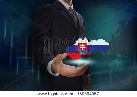 Businessman showing map of Slovakia on globe background