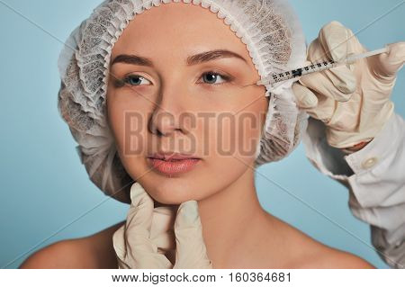 Attractive Young Woman Gets Cosmetic Injection