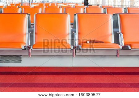 Empty Seat In Departure Lounge Of Airport